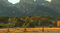 Grand Tetons in Fall with Fence Zoom Out Stock Footage