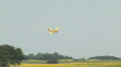 Crop spray plane banks down in approach to apply herbicide Stock Footage