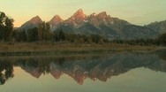 Sun Rising on Grand Tetons Time Lapse Stock Footage