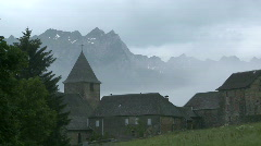Mountain village engulfed in clouds Stock Footage
