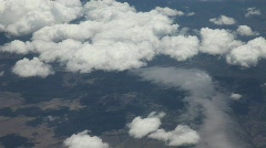 Aerial View of Clouds and Ground from Airplane - stock footage