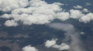 Aerial View of Clouds and Ground from Airplane Stock Footage