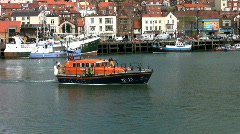 Filey lifeboat leaving the port of Scarborough North Yorkshire Stock Footage
