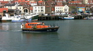 Stock Video Footage of Filey lifeboat leaving the port of Scarborough North Yorkshire