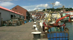 Fishing boats at the fish market at the port of Scarborough North Yorkshire Stock Footage