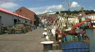 Stock Video Footage of Fishing boats at the fish market at the port of Scarborough North Yorkshire