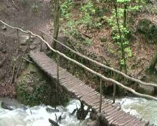 Man walking bridge Stock Footage