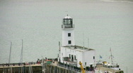 Stock Video Footage of Lighthouse and harbour entrance at Scarborough North Yorkshire