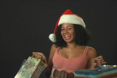 Beautiful Young Santa's Helper with Shopping Bags Stock Footage