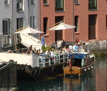 Floating restaurant on canal Alesund Norway Stock Footage