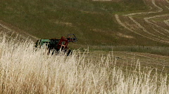 Tractor and baler Stock Footage
