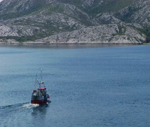 Small Norwegian fishing boat sailing at sea Stock Footage