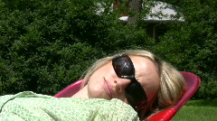 vid022 woman relaxing in lawn chair - stock footage