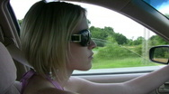 Vid029 woman driving in car with shades Stock Footage