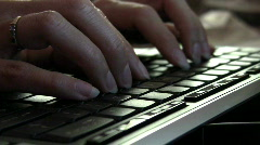 Hands typing on keyboard Stock Footage