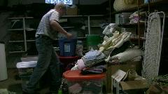 Vid037 man walking over messy storage Stock Footage