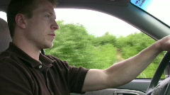vid039 man driving in car - stock footage