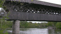 Covered bridge pan from the river below Stock Footage