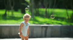 The girl and soap bubbles Stock Footage