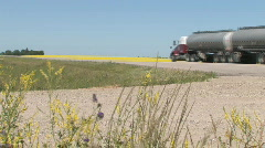 Highway Truck rolling by Canola field 002 Stock Footage