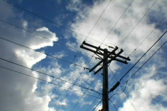 Utility pole with clouds Stock Footage