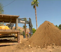 Road construction digging giant hole Stock Footage