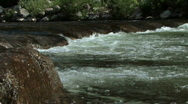 Mountain creek with tiny waterfall Stock Footage