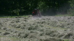 Hay racking with a tractor - stock footage
