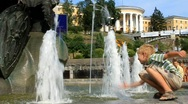 Boy and fountain Stock Footage