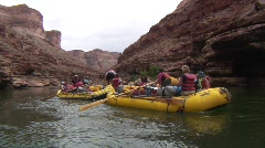 Group of people in yellow paddle boats on colorado river, grand canyon Stock Footage