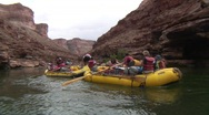 Stock Video Footage of group of people in yellow paddle boats on colorado river, grand canyon