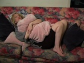 Lovely Young Blonde Daydreaming on the Sofa (1) Stock Footage