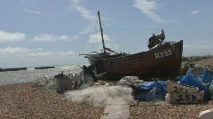 Fishing boat on a beach - stock footage