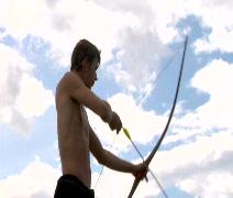 Boy shoots Arrows CU - stock footage