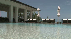 Stock Video Footage of Relaxing Poolside Spa by the Ocean