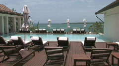 Luxurious inifity pool by the ocean Stock Footage