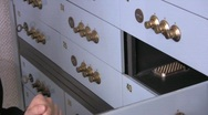 Stock Video Footage of checking a vault contents