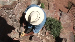 Man working building wall in southwest Stock Footage