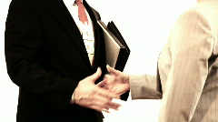 Businessman and client shake hands Stock Footage