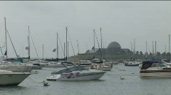 Boats in Monroe Harbor (Lake Michigan) on a rainy, overcast day facing southeast Stock Footage