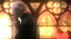 Fixed priest pray window dolly shot 2 - stock footage