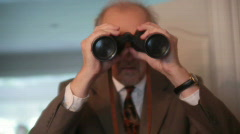 Dismay binoculars looking spy spying suprised Stock Footage