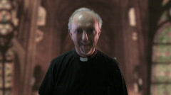 Priest laughing fixed Stock Footage