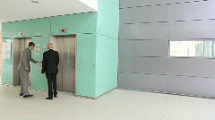 Woman missing elevator TWO TAKES Stock Footage