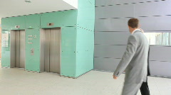 Woman catching elevator TWO TAKES Stock Footage