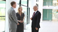 Businesspeople in discussion closer Stock Footage
