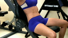 Young woman pressing weights on benchpress - 6 Stock Footage