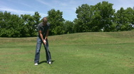 Vid044 man golfing Stock Footage