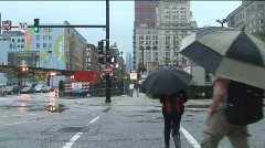Pedestrians crossing at Harrison and Wabash, Chicago, IL; rainy, overcast day Stock Footage