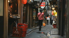 Narrow alley with restaurants and people in Tokyo Stock Footage
